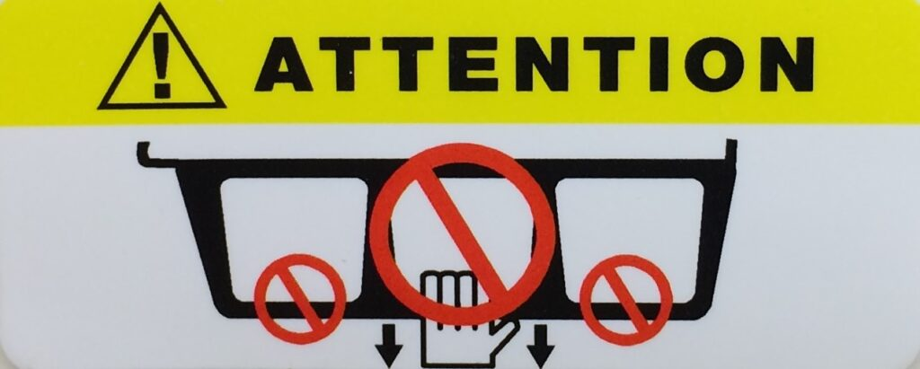 Do Not Position Patient label placed on MRI Coils